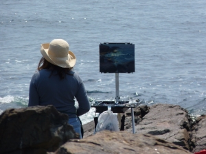 Artist sitting in rocks